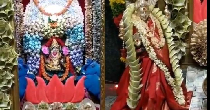 Kanyaka Parameswari Goddess temple in Telangana has been decorated with origami flowers made of currency notes