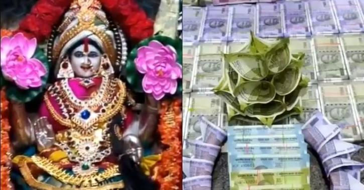 Deity adorned with origami flowers made from the currency notes of various denominations