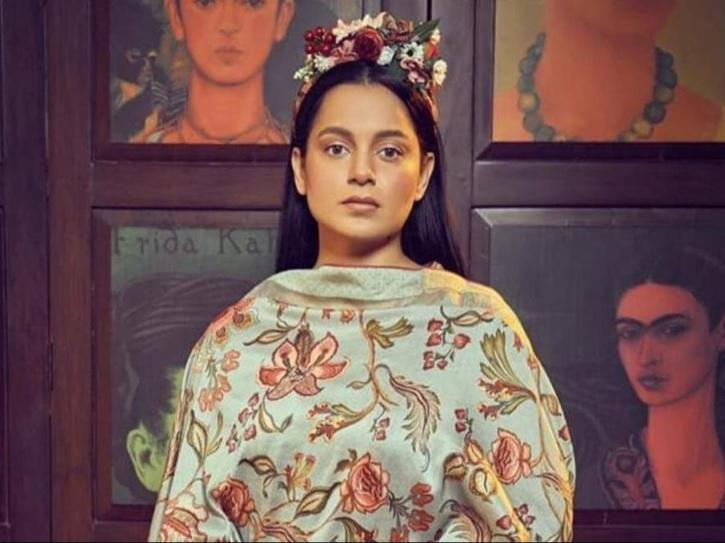 A photo of Kangana Ranaut sporting a flower tiara.