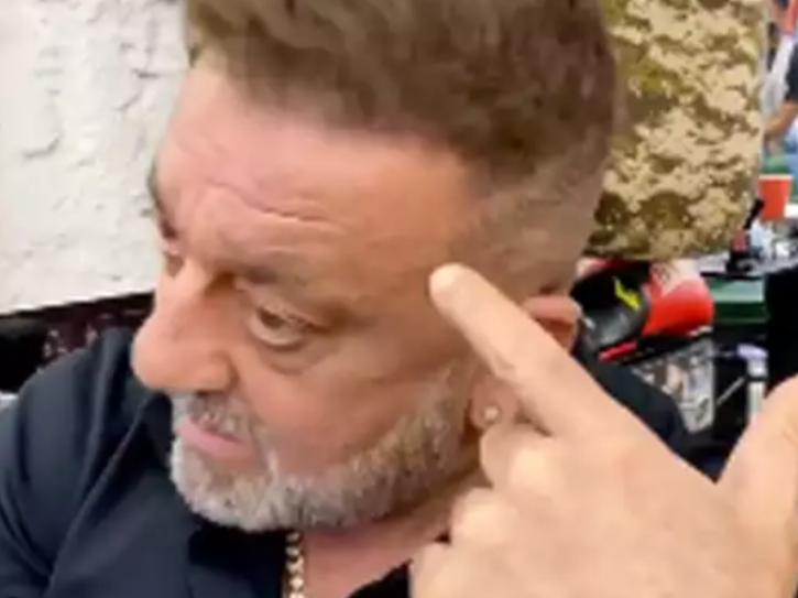 Sanjay Dutt shows his scar designed by hairstylist Aalim Hakim.