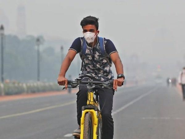Man cycling in pollution