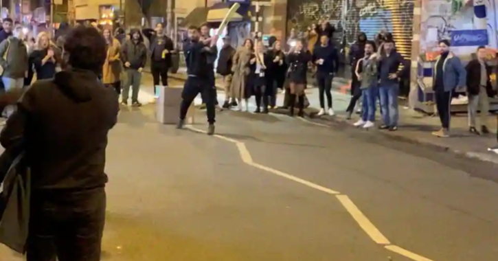 People play cricket in London street