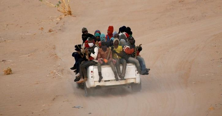 Migrants crossing Sahara desert into Libya on a ride