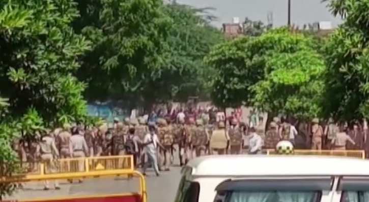 Visuals of the clash showed angry protesters throwing stones at the police and shouting slogans, while dozens of cops, equipped with riot gear and lathis, tried to restore order.