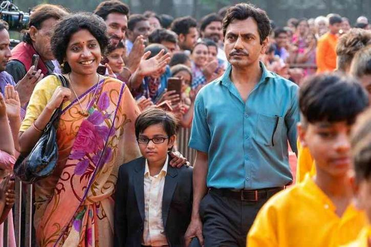 Indira Tiwari, Aakshath Das and Nawazuddin Siddiqui in Serious Men (2020) / Netflix India