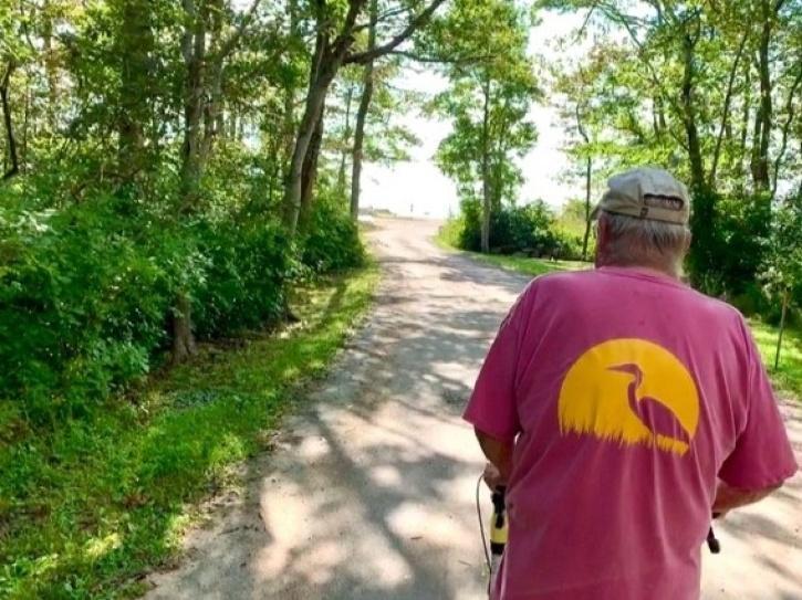 Brad walking on road