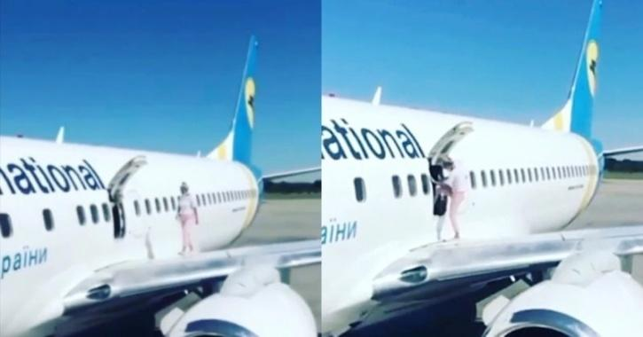 Woman Walks Out Aircraft Wing