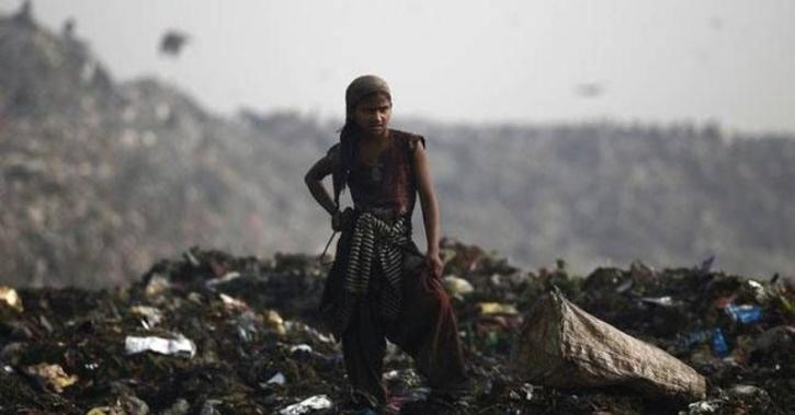 Neha Vasava and a six-year-old boy were on top of a 25-30 metre (80-100 feet) mountain of trash