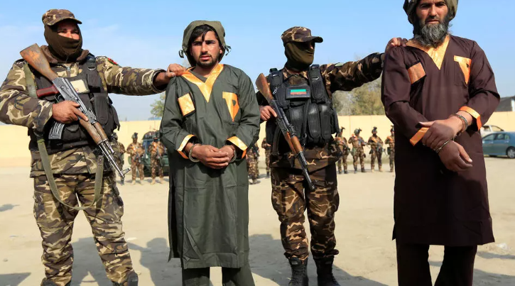 Captured Taliban insurgents are presented to the media