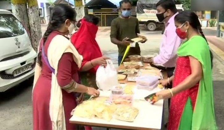 visually impaired man and his wife selling snacks