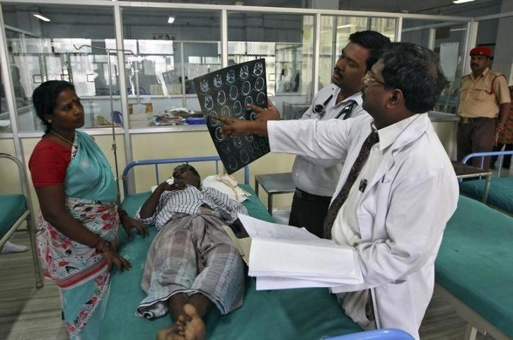 doctors looking at x-ray of patient india