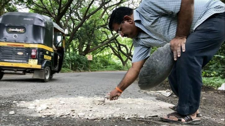 Mr. Wadhva filling a pothole