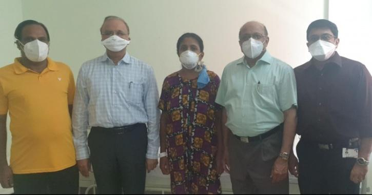 Sindu with her husband and doctors