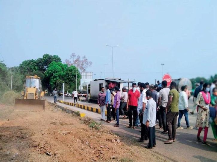 Villagers in coastal Karnataka, used a bulldozer to construct a 'parallel' road to bypass the booth.