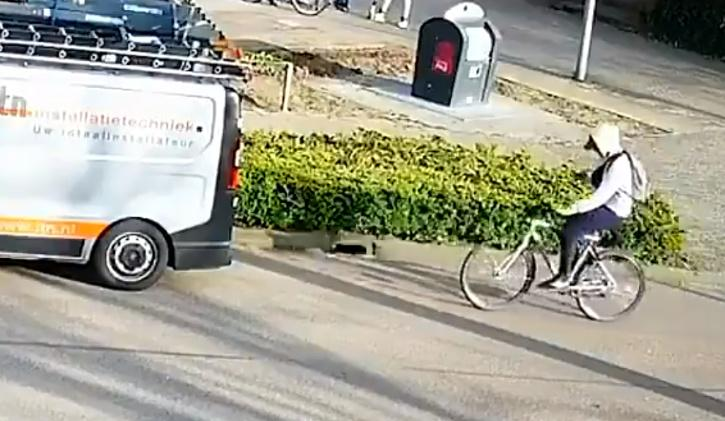 cyclist busy on his phone crashes straight into van