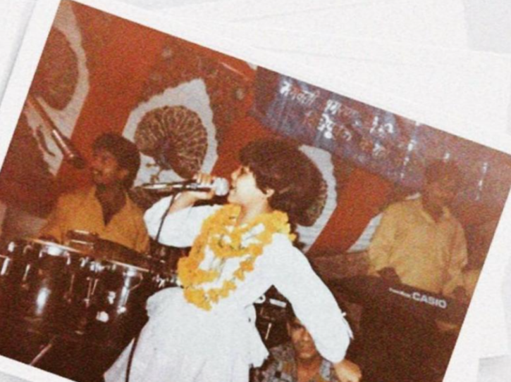 Neha Kakkar performing bhajans at religious events and gatherings.