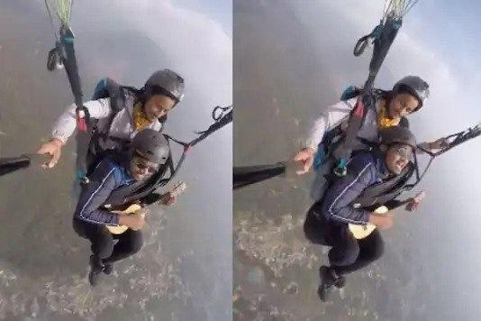 paragliding man sings Maa Tujhe Salam