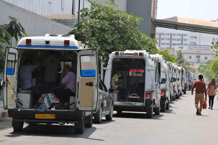 Ambulances carrying Covid-19 patients line up outside a government hospital in Ahmedabad on April 22