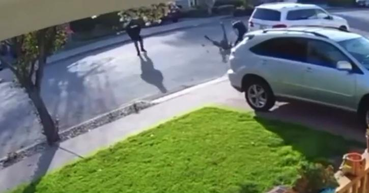 When the robber with the weapon got close enough to the victim, the man swiftly stepped back and grabbed the robber, body slamming him to the ground.