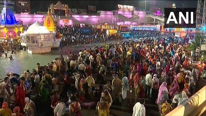 The huge crowd flocked to Har Ki Pauri ghat on the banks of the holy river for Shahi Snan or royal bath, violating the COVID-19 rules issued by the Health Ministry.