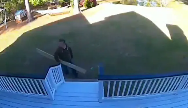 The hilarious incident was recorded on the home security system and the man's wife shared the video on social media.