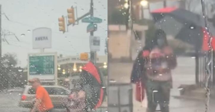 man gives umbrella to woman standing in rain