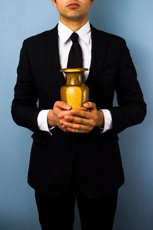 man holding an urn