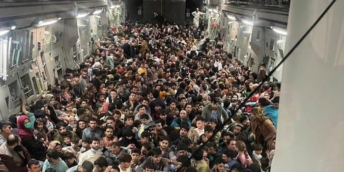 Evacuees crowd the interior of a US Air Force C-17 Globemaster