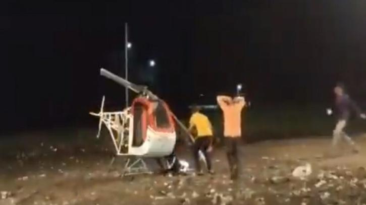 ismail lying outside his helicopter after accident