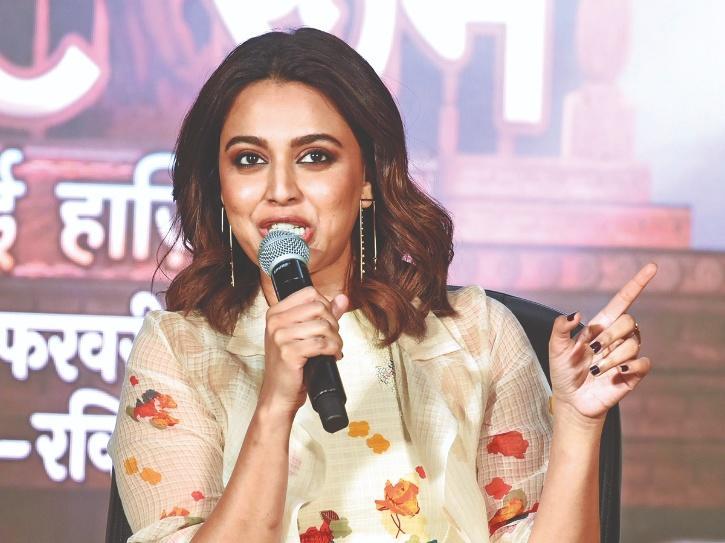 Swara bhasker with a mic.