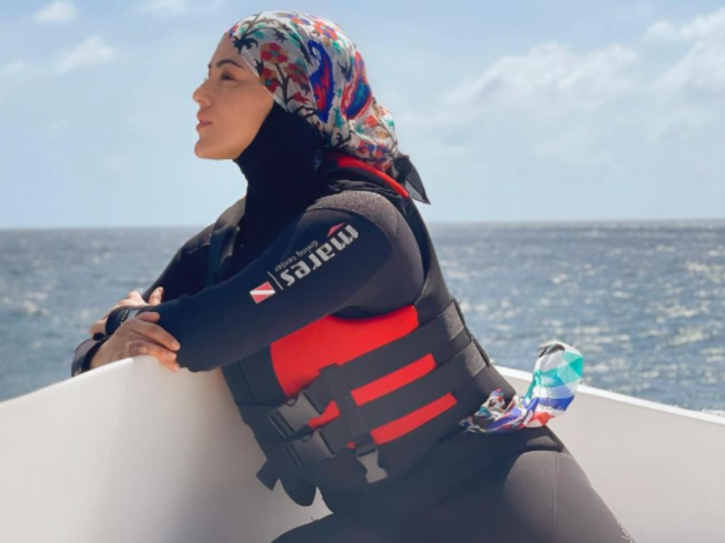 A photo of Sana Khan wearing Hijab as she goes for snorkelling.