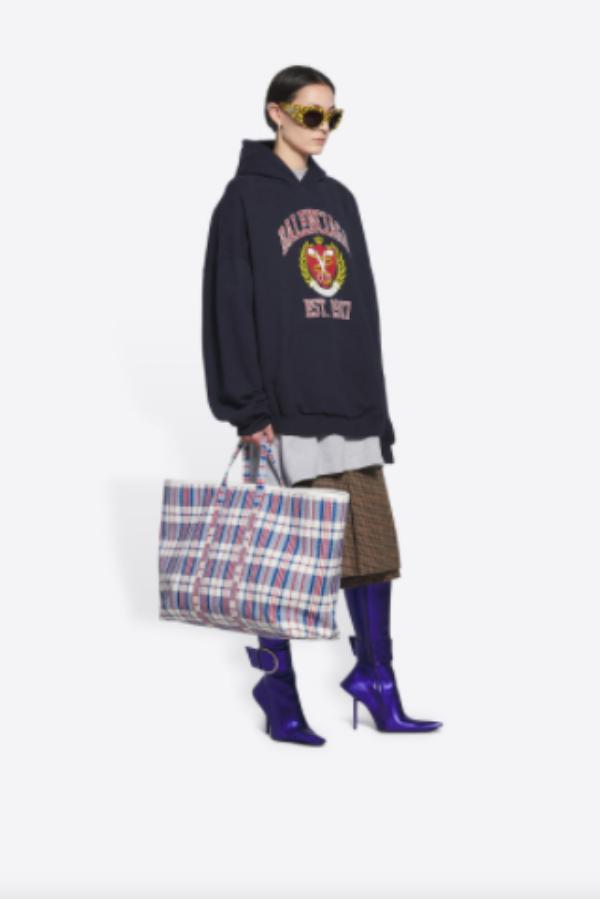 Model Holds balenciaga bag