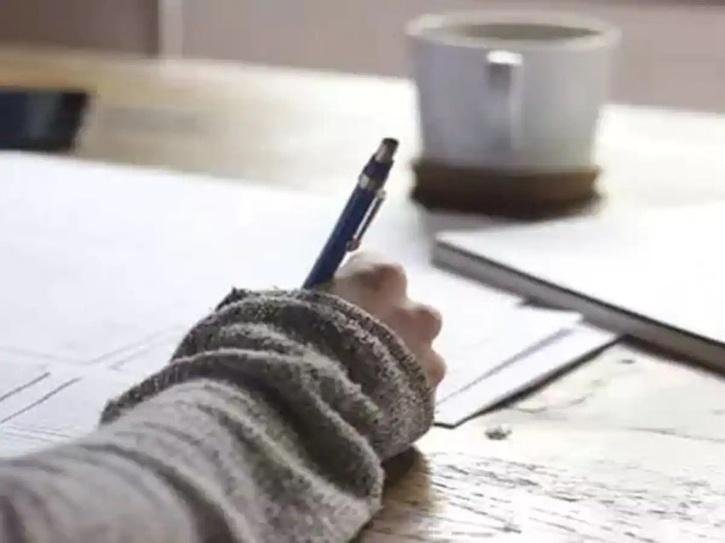 Student writing in exams