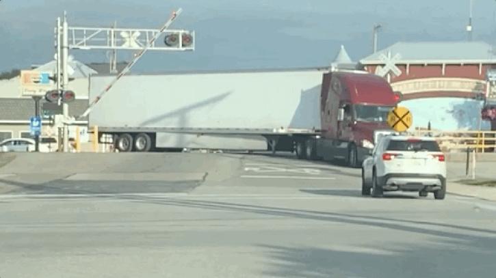 Freight train destroys semi truck in its path