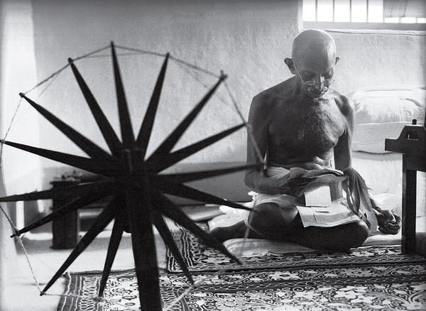 Gandhi and the Spinning Wheel by Margaret Bourke-White, 1946