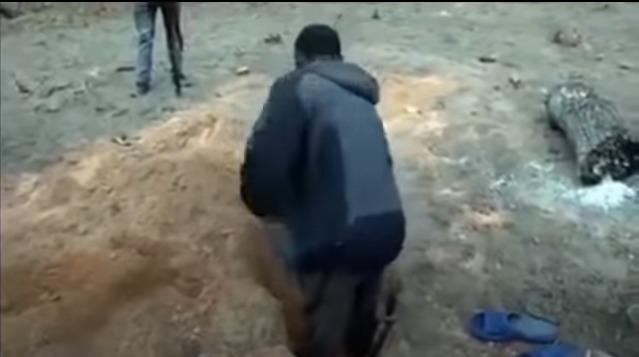 man digging the grave