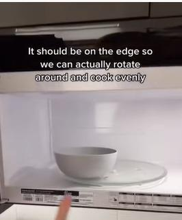 microwaving techniques by woman