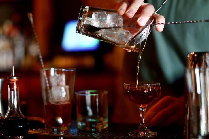 Bartender pouring drinks.