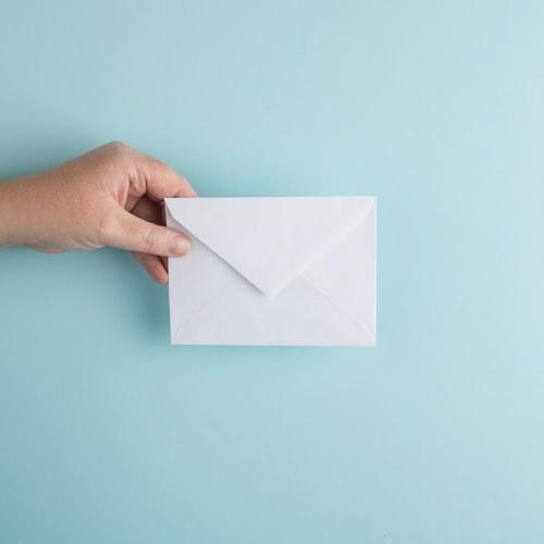 person holding an envelope