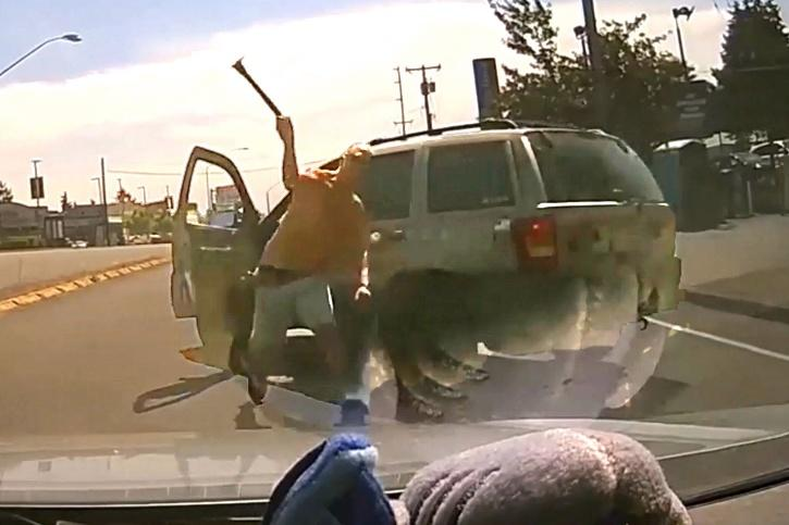 Driver hurls hammer at through vehicle's window in road-rage.