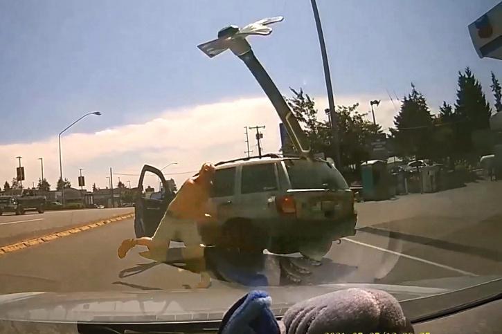 Man hurls hammer in road-rage.