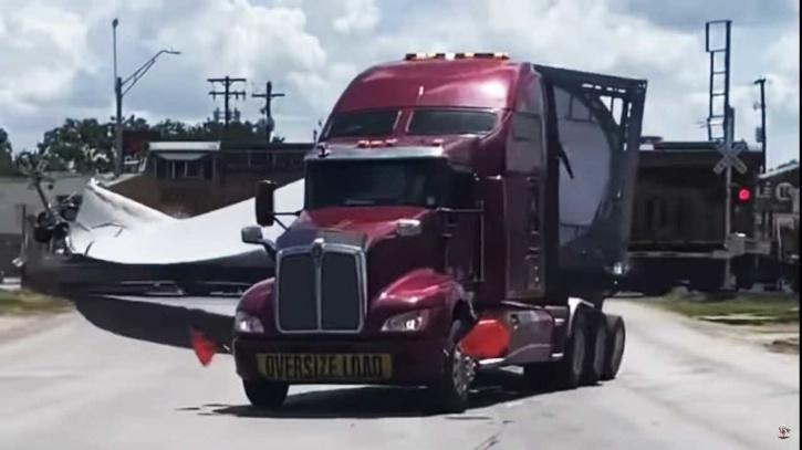 Train smashes into 18-wheeler carrying wind turbine blade
