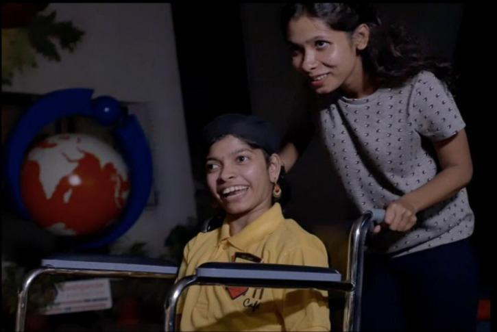 alina with a differently-abled employee