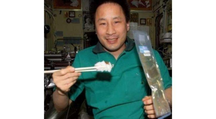 Japanese astronaut eating sushi in space