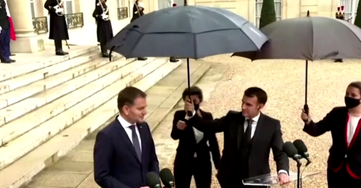 When an Elysee worker offered to take the umbrella from his hand, Macron waved no. Matovic responded with a smile.