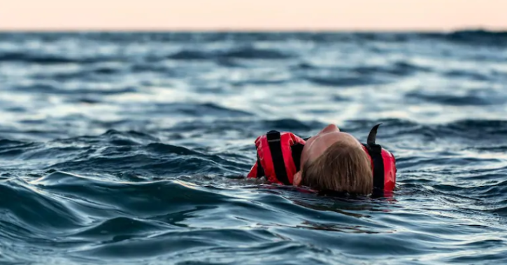 A sailor who fell into the Pacific Ocean without a life jacket survived by clinging to a