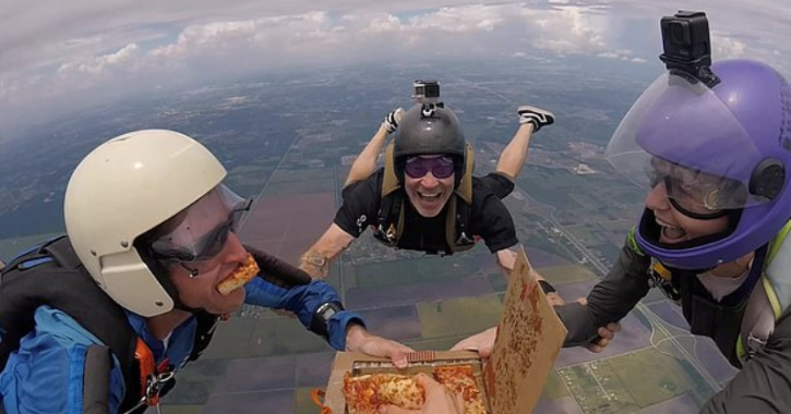 Lori Patalocco, 43, and three others formed a circle around the pizza in mid-air over Houston