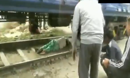 Moments after the train passed, she was helped to her feet by people
