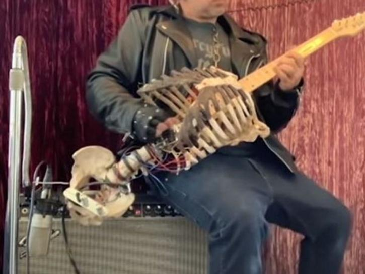 skeleton of dead uncle turned into guitar