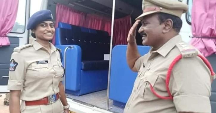 Circle Inspector Shyam Sundar salutes his own daughter Jessi Prasanti who is a Deputy Superintendent of Police with pride